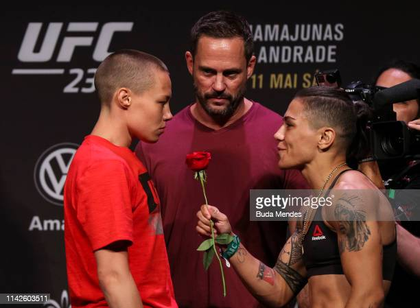 Opponents Rose Namajunas of the United States is presented a rose from Jessica Andrade of Brazil as they face off during the UFC 237 weigh-in at...