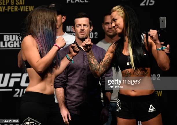 Opponents Sarah Moras of Canada and Ashlee EvansSmith faceoff during the UFC 215 weighin inside the Rogers Place on September 8 2017 in Edmonton...