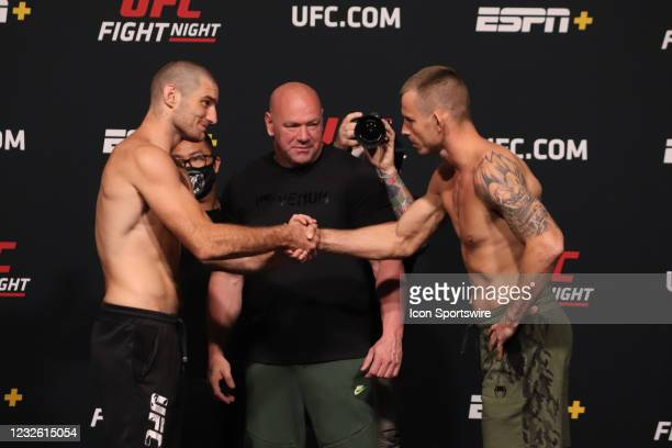 Opponents Sean Strickland and Krzysztof Jotko of Poland face off during the UFC Fight Night: Reyes v Prochazka Weigh-in at UFC Apex on April 30 in...