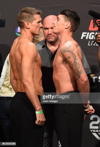 Opponents Stephen Thompson and Darren Till of England face off during the UFC Weighin at ECHO Arena on May 26 2018 in Liverpool England
