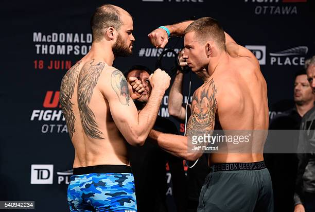 Opponents Tamdan McCrory of the United States and Krzysztof Jotko of Poland face off during the UFC Fight Night Weighin inside the Arena at TD Place...