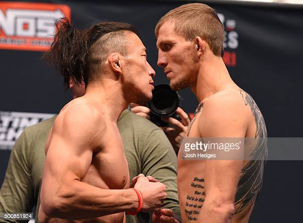 Opponents Tatsuya Kawajiri of Japan and Jason Knight face off during the UFC weighin inside MGM Grand Garden Arena on December 10 2015 in Las Vegas...