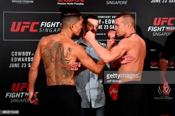 Opponents Teruto Ishihara of Japan and Petr Yan face off during the UFC Fight Night weighin at the Mandarin Oriental on June 22 2018 in Singapore