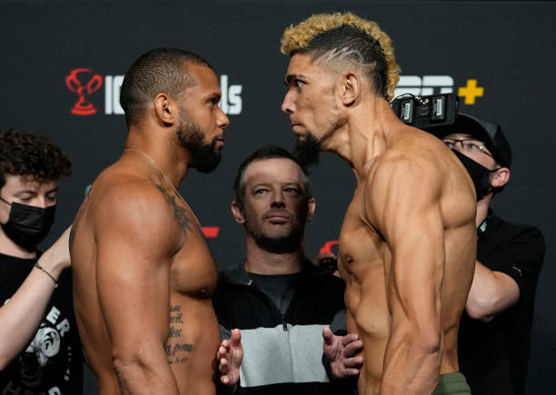 Opponents Thiago Santos of Brazil and Johnny Walker of Brazil face off during the UFC Fight Night weigh-in at UFC APEX on October 01, 2021 in Las...