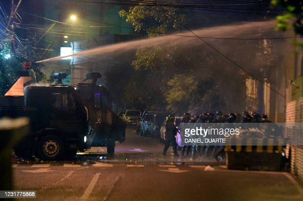 Opponents to Paraguayan President Mario Abdo Benitez clash with riot police while waiting for the veredict of the accusatory libel for his political...
