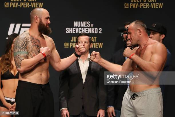 Opponents Travis Browne and Aleksei Oleinik of Russia face off during the UFC weighin at the Park Theater on July 7 2017 in Las Vegas Nevada