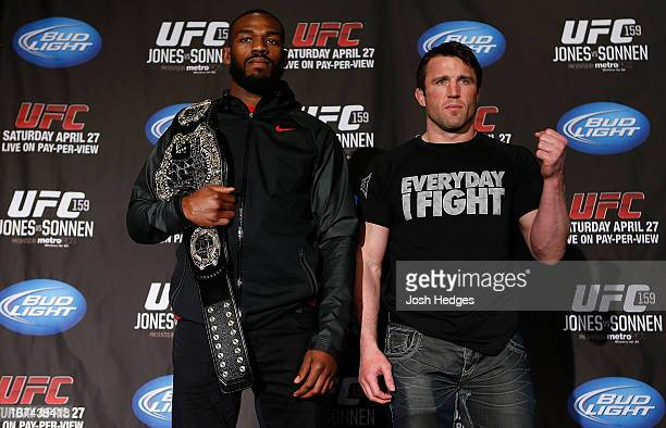 Opponents UFC Light Heavyweight Champion Jon Bones Jones and Chael Sonnen pose for photos during UFC 159 media day at The Theater at Madison Square...