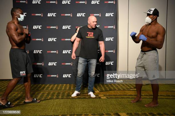 Opponents Uriah Hall of Jamaica and Jacare Souza of Brazil face off during the UFC 249 official weighin on May 08 2020 in Jacksonville Florida
