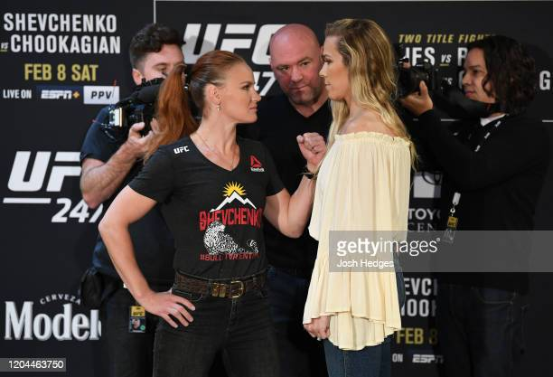 Opponents Valentina Shevchenko of Kyrgyzstan and Katlyn Chookagian face off during the UFC 247 Ultimate Media Day at the Crowne Plaza Houston River...
