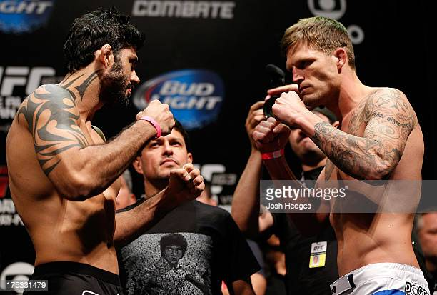 Opponents Viscardi Andrade and Bristol Marunde face off during the UFC 163 weighin at HSBC Arena on August 2 2013 in Rio de Janeiro Brazil
