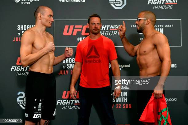 Opponents Vitor Miranda of Brazil and Abu Azaitar of Germany face off during the UFC Fight Night Weighin event at the Radisson Blu Hotel on July 21...