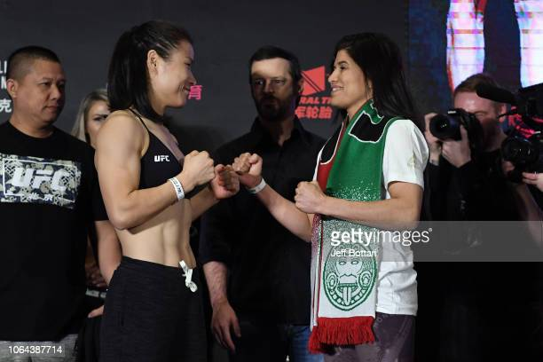 Opponents Weili Zhang of China and Jessica Aguilar of Mexico face off during the UFC Fight Night weighin on November 23 2018 in Beijing China