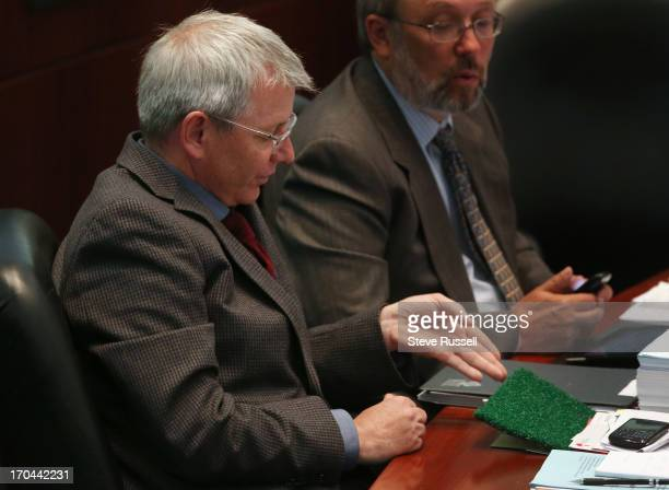 Opposed to the field conversion in his ward Adam Vaughan questions a the city's field specialist about the type of turf that will be used as city...