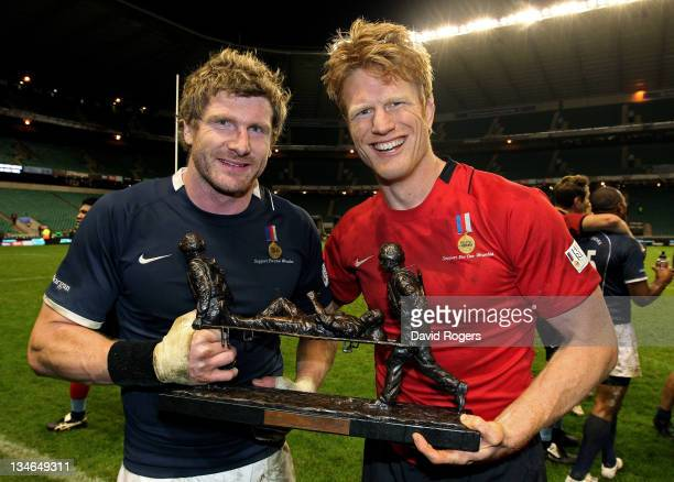 Opposing captains Adam Thomson of the Southern Hemisphere XV and Hugh Vyvyan of the H4H Northern Hemisphere XV pose with the trophy following the...