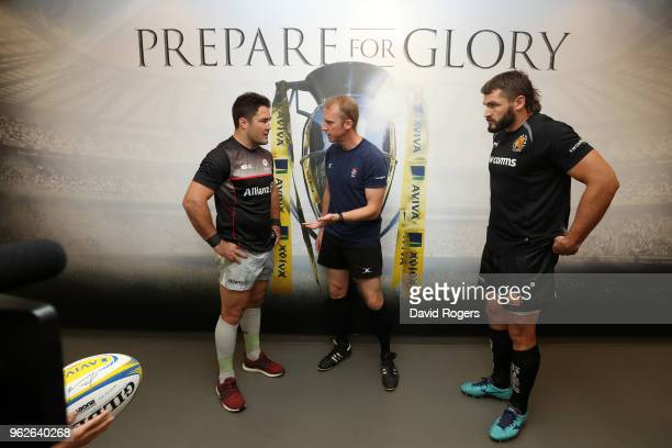 Opposing captains Brad Barritt of Saracens and Don Armand of Exeter Chiefs toss the coin under the watchful eye of referee Wayne Barnes prior to the...