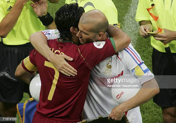 Opposing captains Luis Figo of Portugal and Zinedine Zidane of France hug each other prior to kickoff during the FIFA World Cup Germany 2006...