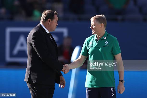Opposing coaches Steve Hansen the head coach of New Zealand and Joe Schmidt the head coach of Ireland shake hands prior to kickoff during the...