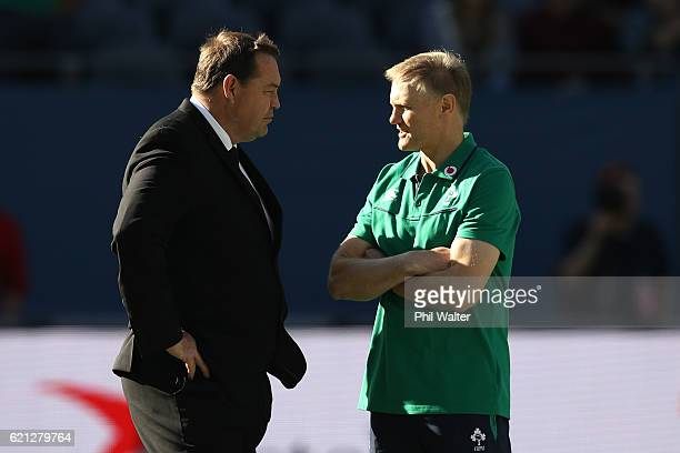Opposing coaches Steve Hansen the head coach of New Zealand and Joe Schmidt the head coach of Ireland chat prior to kickoff during the international...