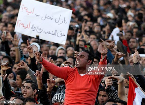 Opposing demonstrators clash in Tarhrir Square on January 27 2012 in Cairo Eygpt Protestors continue to gather just days after tens of thousands...