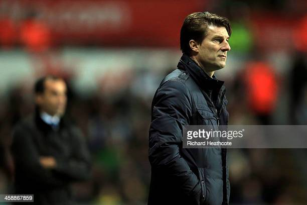 Opposing managers Michael Laudrup the Swansea manager and Roberto Martinez the Everton manager look on during the Barclays Premier League match...