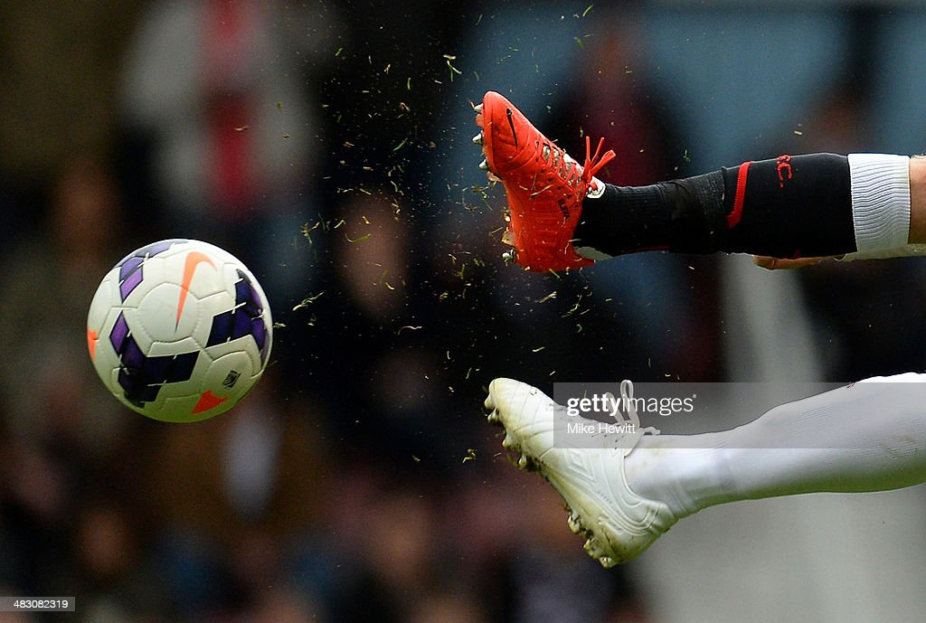 Opposing players challenge for the ball during the Barclays Premier League match between West Ham United and Liverpool at Boleyn Ground on April 6, 2014 in London, England.