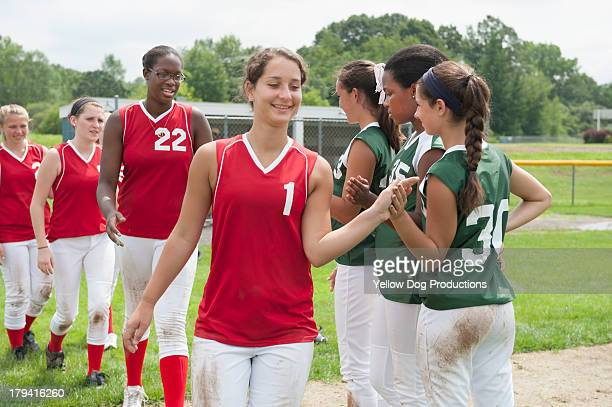 opposing players shaking hands after game - softball sport stock pictures, royalty-free photos & images