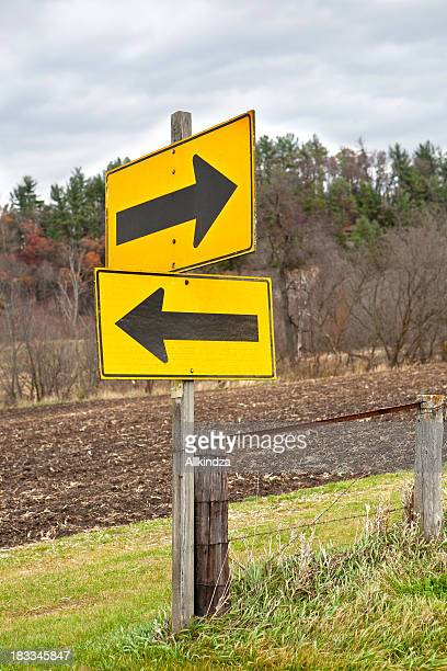 opposite arrows sign - misinformation stock pictures, royalty-free photos & images