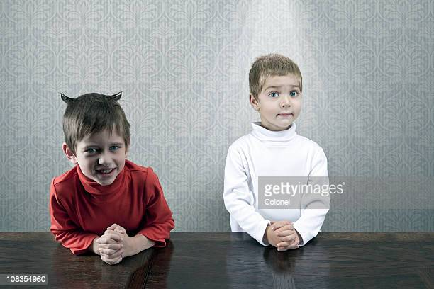 opposite personalities - evil stock photos and pictures