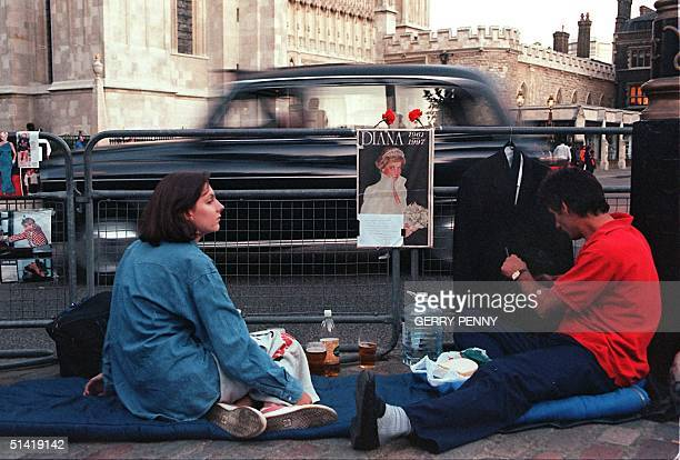 Opposite Westminister Abbey where the funeral of Diana Princess of Wales will take place on Saturday a couple set up camp fully prepared for the...