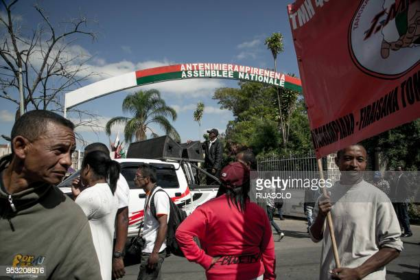 Opposition activists accompanied by supporters ask employees of the National Assembly to lay down work during an anti-government demonstration, in...