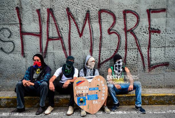 TOPSHOT Opposition activists are pictured next to the site where young activist Neomar Lander was mortally wounded during clashes with riot police...