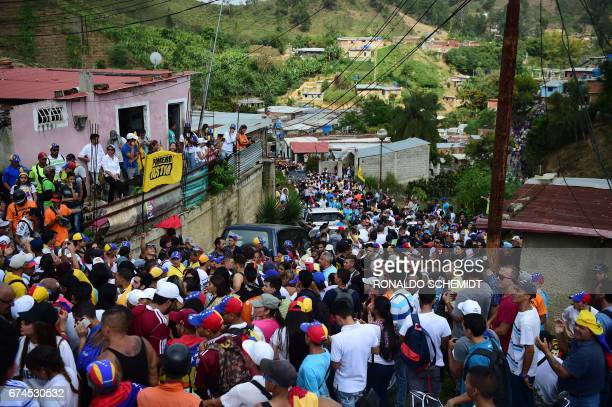 Opposition activists are stopped by riot police a few kilometres before the entrance of the Ramo Verde penitentiary in Los Teques 30 km east of...