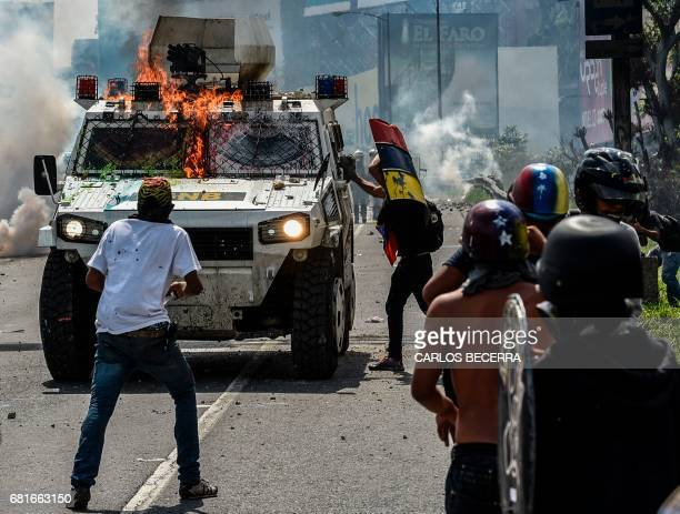 Opposition activists clash with riot police during a protest against President Nicolas Maduro in Caracas on May 10 2017 Venezuelan protesters hit the...