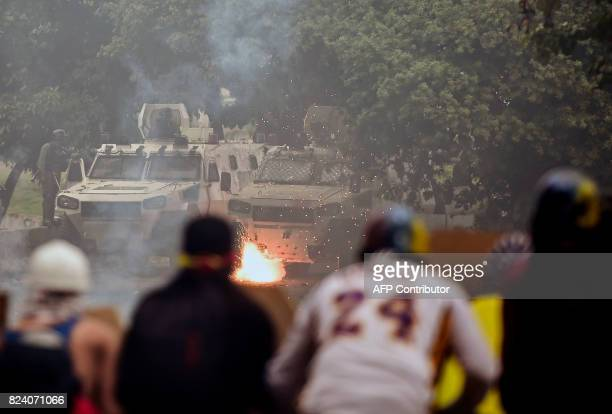Opposition activists clash with riot police during a protest against President Nicolas Maduro's government and in defiance of a new ban on rallies...