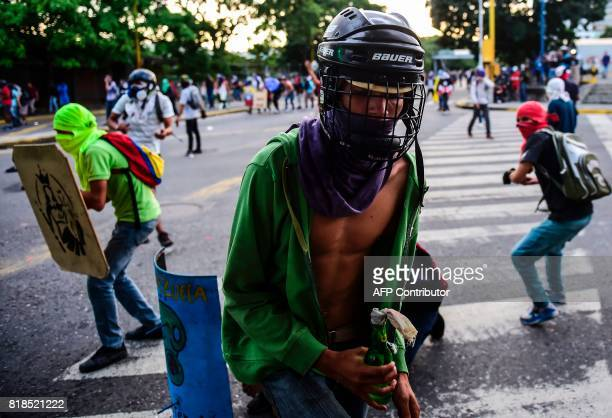 Opposition activists clash with the police during a protest against Venezuelan President Nicolas Maduro in Caracas on July 18 2017 Venezuela's...