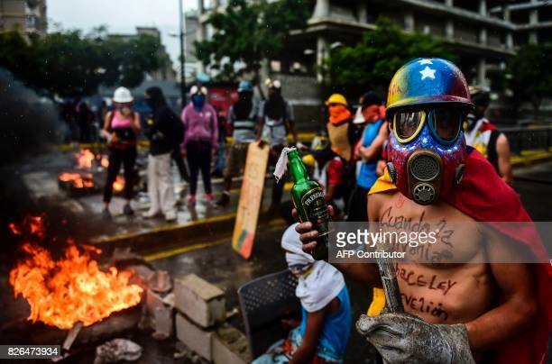 Opposition activists hold a protest against the newly inaugurated Constituent Assembly in Caracas on August 4 2017 Venezuelan President Nicolas...