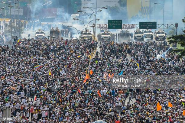 TOPSHOT Opposition activists march along Francisco Fajardo highway during a protest against President Nicolas Maduro in Caracas on May 10 2017...