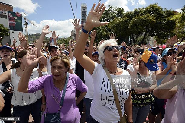Opposition activists march in Caracas on February 15 2014 Venezuela braced Saturday for dueling protests pro and antigovernment a day after police...