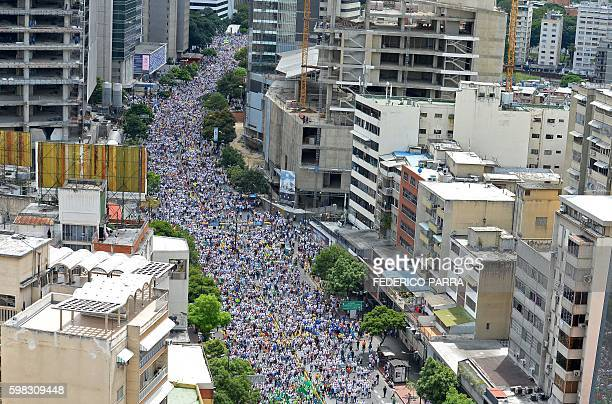 TOPSHOT Opposition activists march in Caracas on September 1 2016 Venezuela's opposition and government head into a crucial test of strength Thursday...