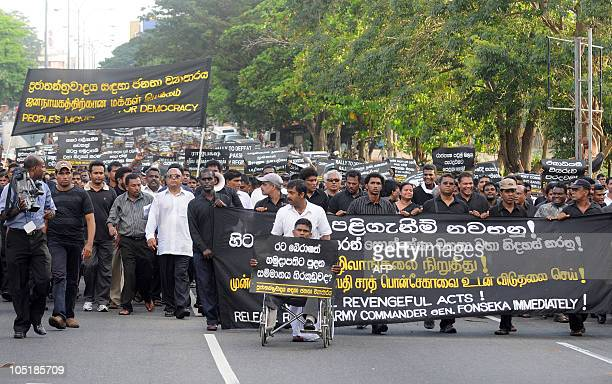 Opposition activists of the jailed former army chief Sarath Fonseka's political party hold a demonstration outside the main prison in Colombo on...