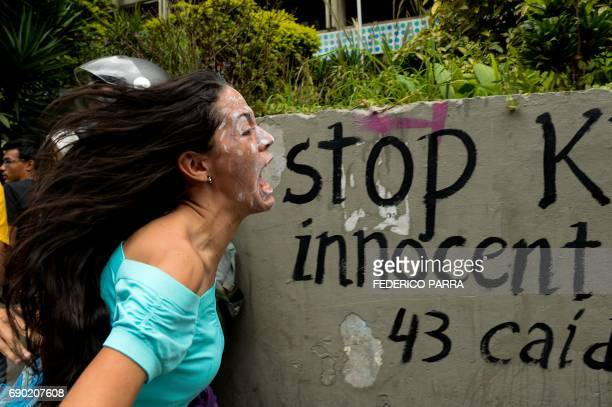 TOPSHOT Opposition activists protest against President Nicolas Maduro's government in Caracas on May 30 2017 Two leading Venezuelan opposition...