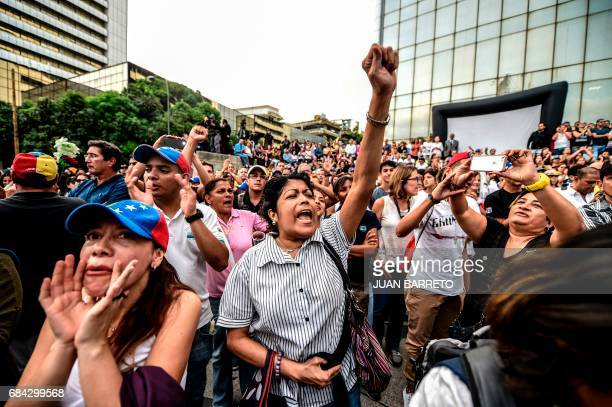 TOPSHOT Opposition activists protest against the deaths of 43 people in clashes with the police during weeks of demonstrations against the government...