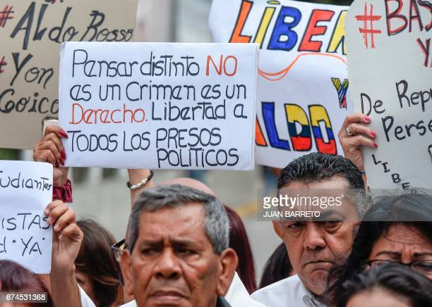 Opposition activists protest against the government of Venezuelan President Nicolas Maduro outside the Bolivarian Intelligence Service station in...
