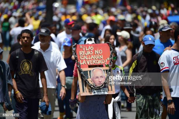 TOPSHOT Opposition activists protest in Caracas on August 12 2017 US President Donald Trump's 'reckless threat' of possible military force against...