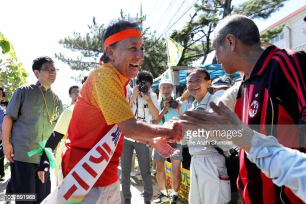 Opposition 'All Okinawa' movement backed candidate Denny Tamaki visits a hut set up by antiUS Airbase relocation protesters as the Okinawa...
