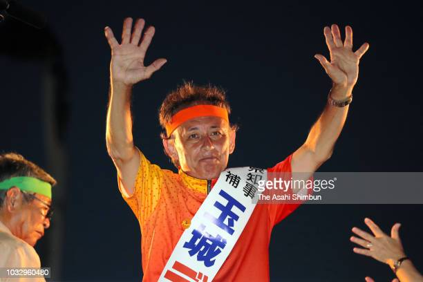 Opposition 'All Okinawa' movement backed candidate Denny Tamaki waves to his supporters during a street speech in front of the Okinawa Prefecture...