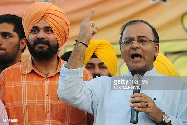 Opposition Bharatiya Janata Party General Secretary Arun Jaitley and Indian cricketer turned politician, sitting Member of Parliament and BJP...