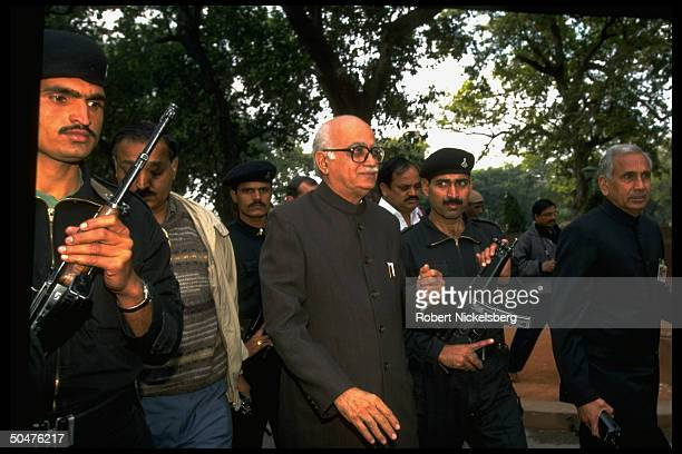 Opposition BJP Bharatiya Janata Party ldr. L.K. Advani w. Armed guards, at protest march re govt. Charges of corruption against 10 maj. Politicians...