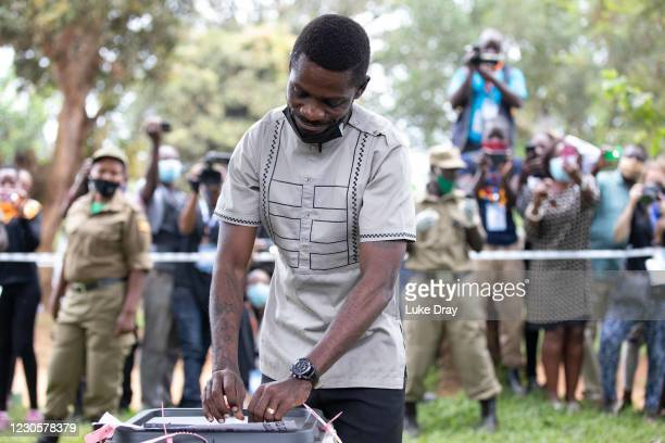 Opposition candidate, Bobi Wine casts his vote in the Ugandan presidential elections on January 14, 2021 in Kampala, Uganda. Observers fear violence...