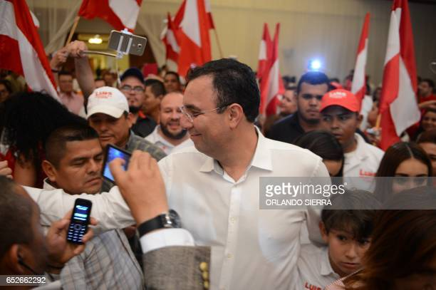 Opposition candidate of the Liberty Party Luis Zelaya meets supporters after declaring victory in the primary elections in Tegucigalpa on March 12...